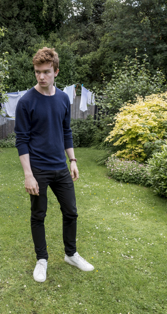 navy Brora cashmere sweater, black Levi's 520 jeans, white Common Projects sneakers